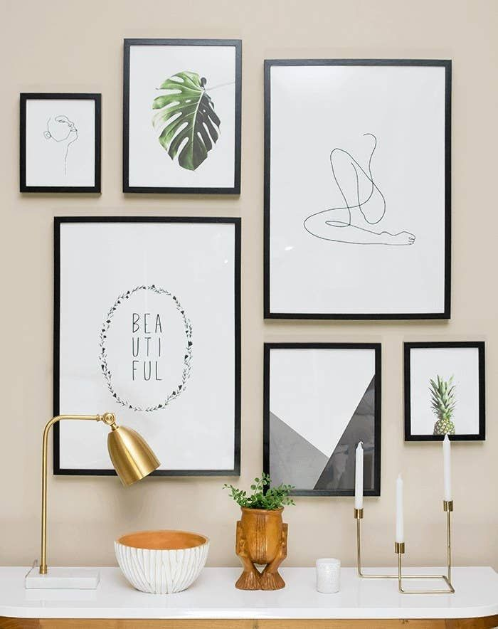 Or hang it so the bottom of the lowest frame is 6 to 12 inches above the furniture. 21 Essential Tips I Wish I'd Known Before Trying To Hang A Gallery Wall