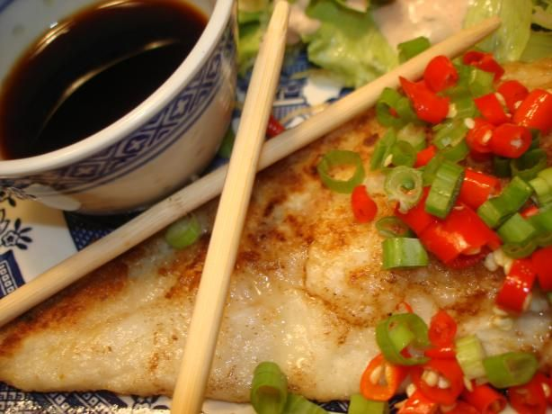 Pan Fried Cod with Asian Dressing  Wow I did not have all ingredients for this so instead of five season I used pepper garlic powder, an cayenne pepper, and olive oil instead of sesame oil. This is one of my favorite fish dish. I recommend a cast iron skillet.