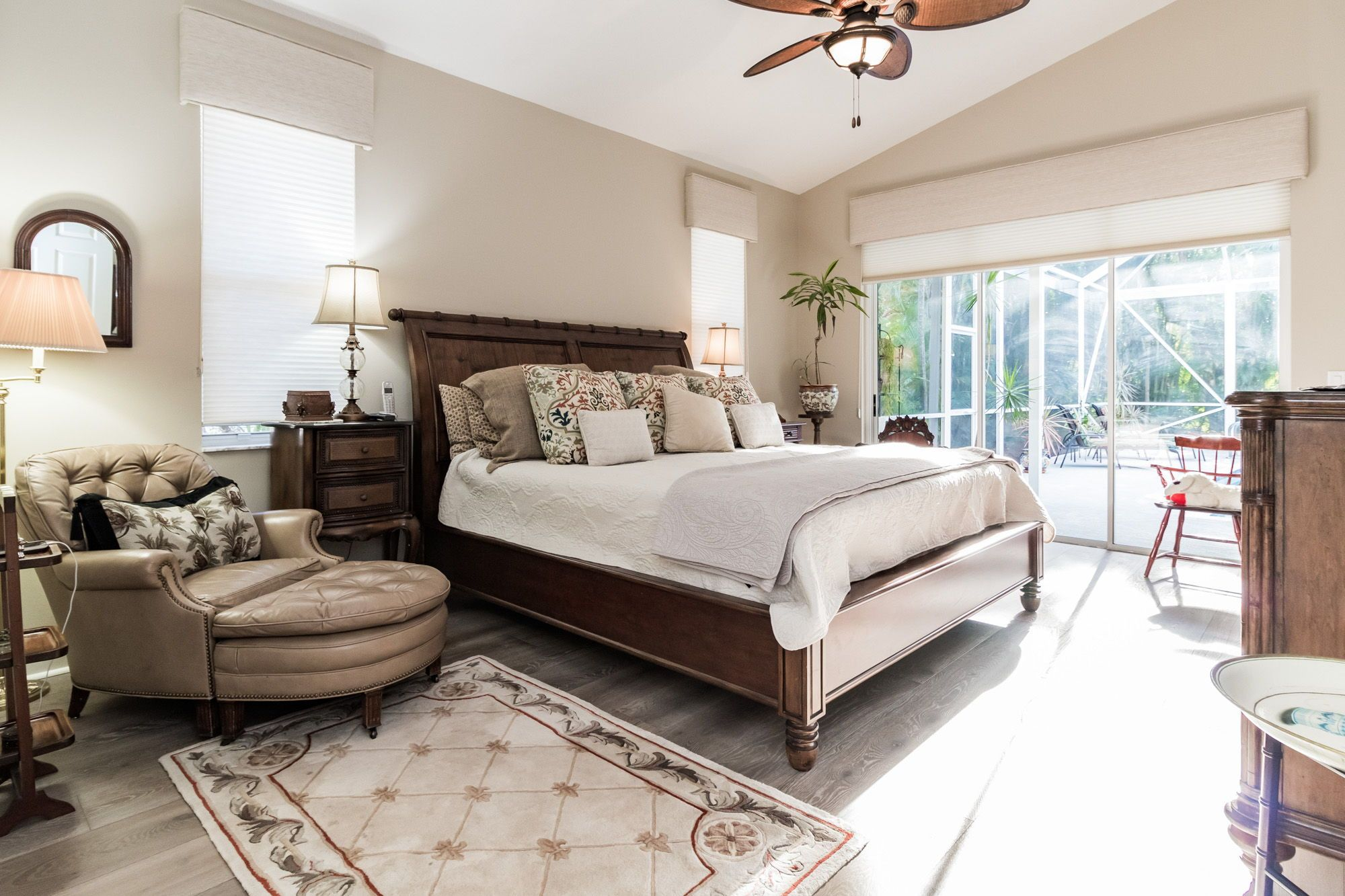 The Master Suite Has Vaulted Ceilings Newer Wood Look Tile Flooring Large Windows And Sliding Glass Door Access To Bedroom Design Luxury Homes Bedroom Decor