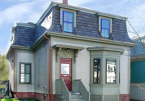 Mansard roof cottage the mansard roof named after the for Mansard roof pros and cons