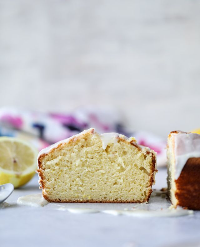 It's one of my favorite sights to see.  Just look at that perfect lemony loaf slice! The only thing prettier might be bundt cake perfection.  This cake falls under my favorite dilemma of… is it cake?