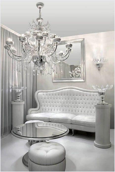 The Sitting Room Of Glam Colette Le Mason White Decor Mirrored Furniture Silver Decor #silver #and #white #living #room #decor