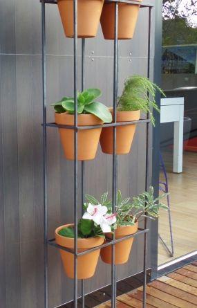 vertical garden handmade steel frame with six terracotta. Black Bedroom Furniture Sets. Home Design Ideas
