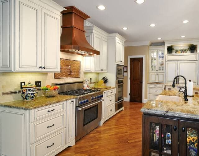 White Kitchen Hood traditional white kitchen with copper range hood..i would want