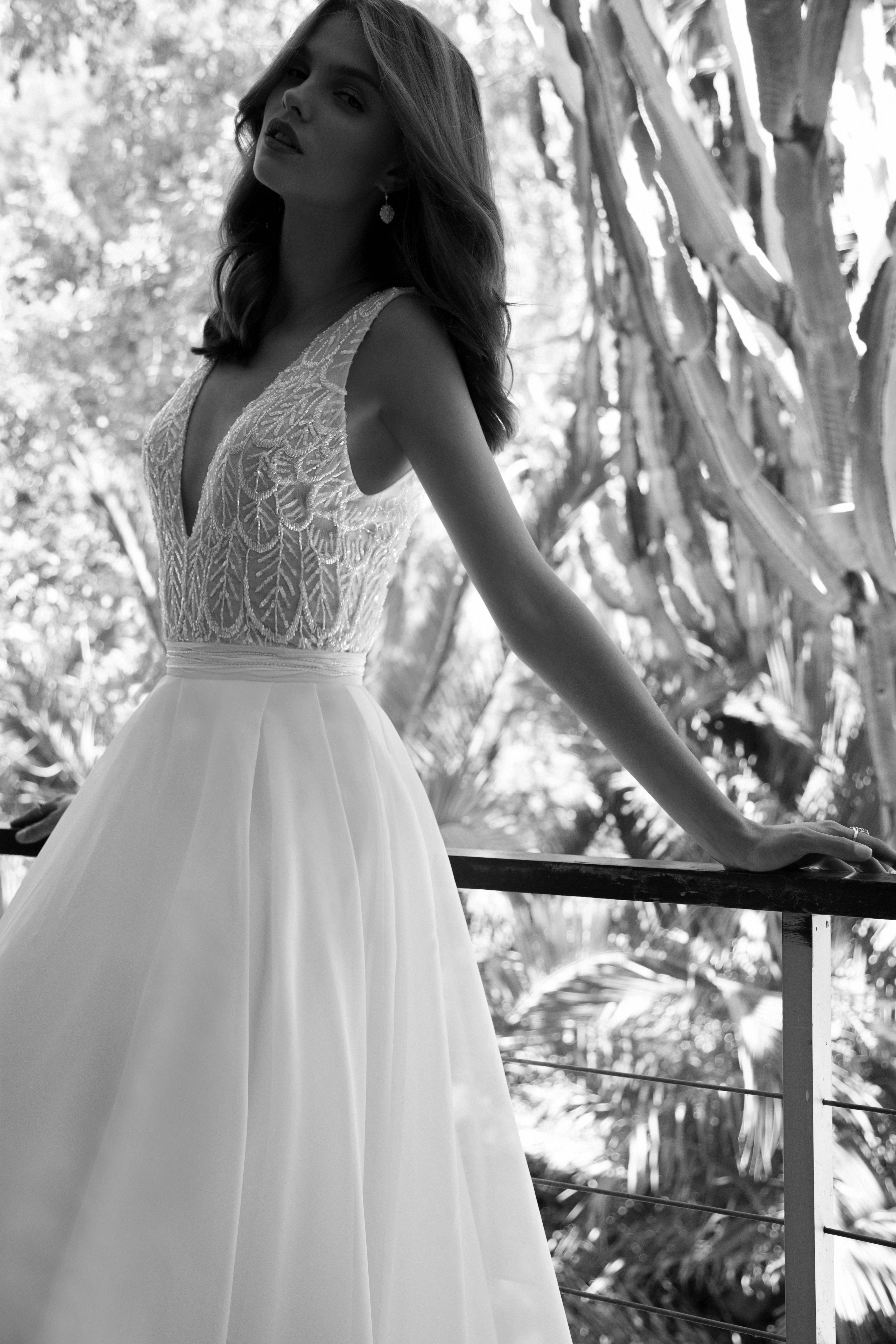 Beaded bodice with natural waist and pleated full a-line organza skirt. Plunging…