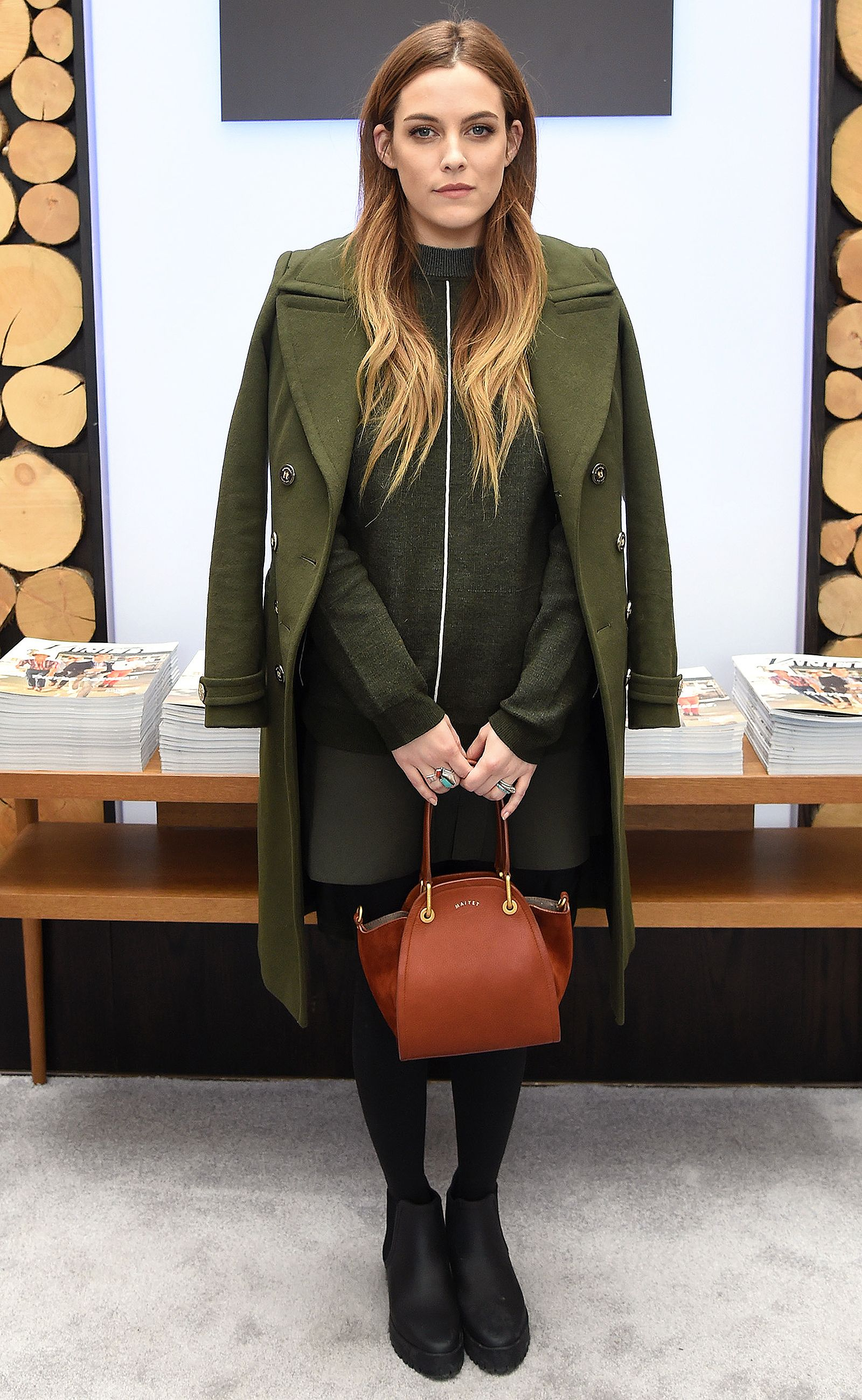 796f03a837 Riley Keough wears a green Sandro sweater