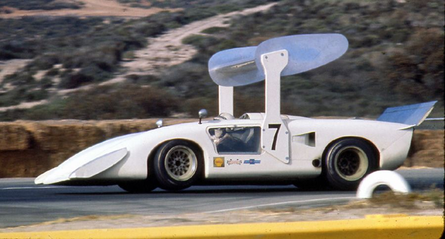 With Surtees at the wheel, the Chaparral 2H lifts its left front wheel off of the tarmac at Laguna Seca. Some believe that the DeDion rear axle/suspension was the biggest contributor to the 2H's handling issues.