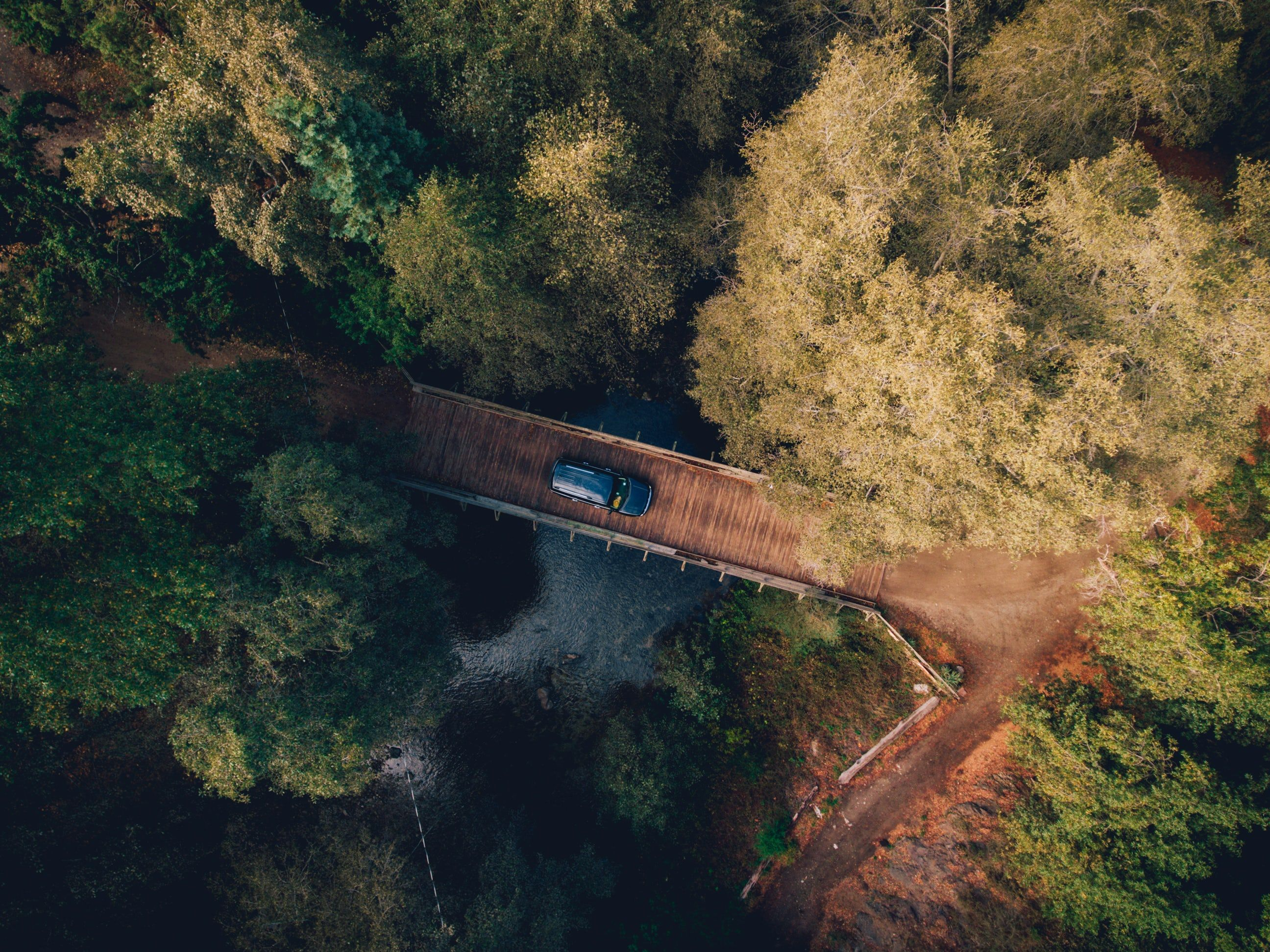 Drone Aerial View Of A Car On A Wooden Bridge In The Forest In Big Sur Aerial View Trip Aerial Photo