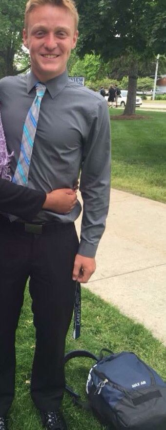 Outfit of the day is a grey shirt with a blue tie, black pants and black shoes.