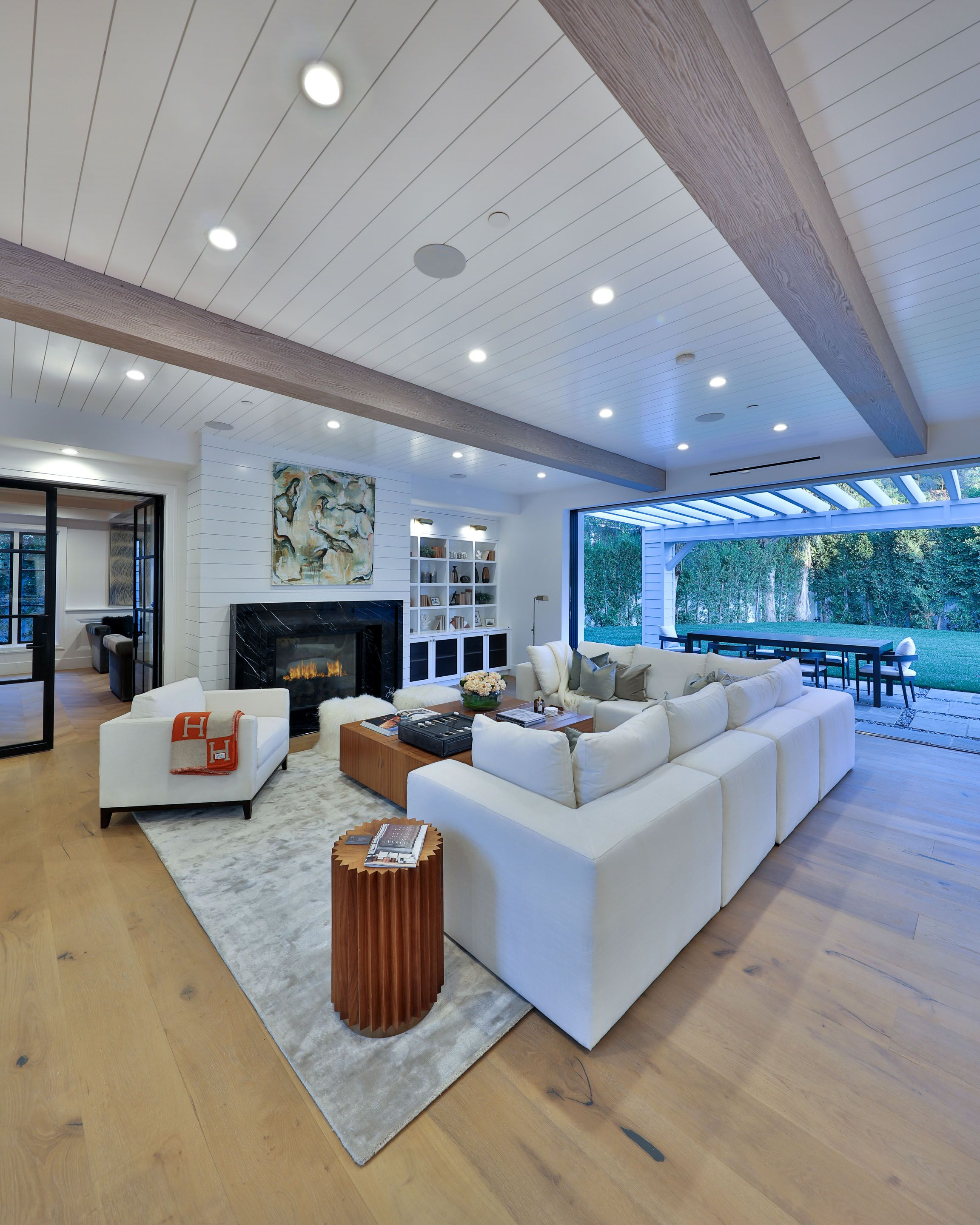 Luxury Modern Farmhouse Living Room With Light Wood Floors And