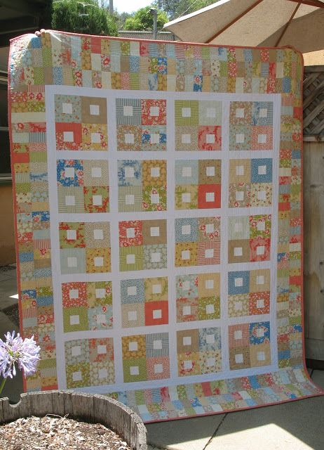 California Girl quilt made with jelly roll, easy square block pattern and strips on all sides