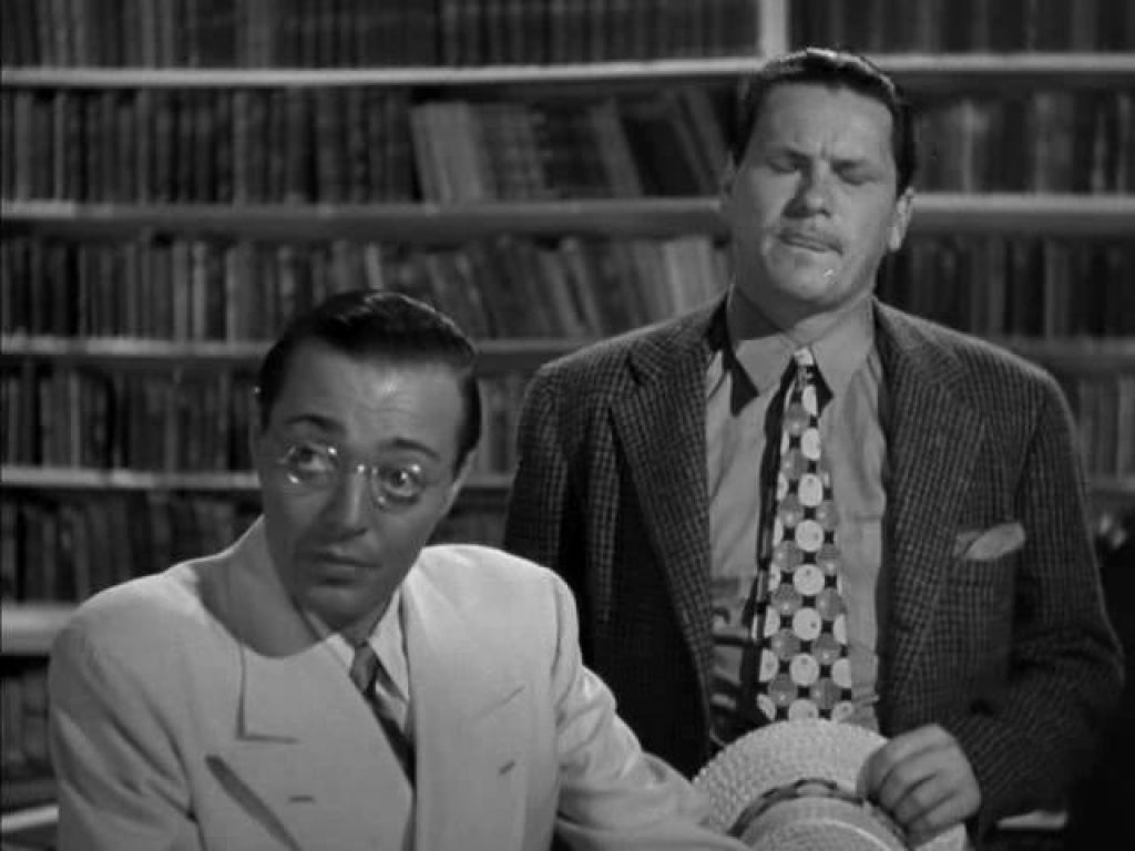 Mr. Moto in Danger Island (1939).  The librarian gives away what would be considered today private information about a patron.