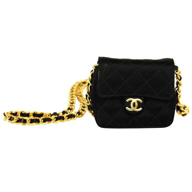 db43779e90235f 1stdibs.com   CHANEL Micro Quilted Black Satin Pouch On Chain   buy ...