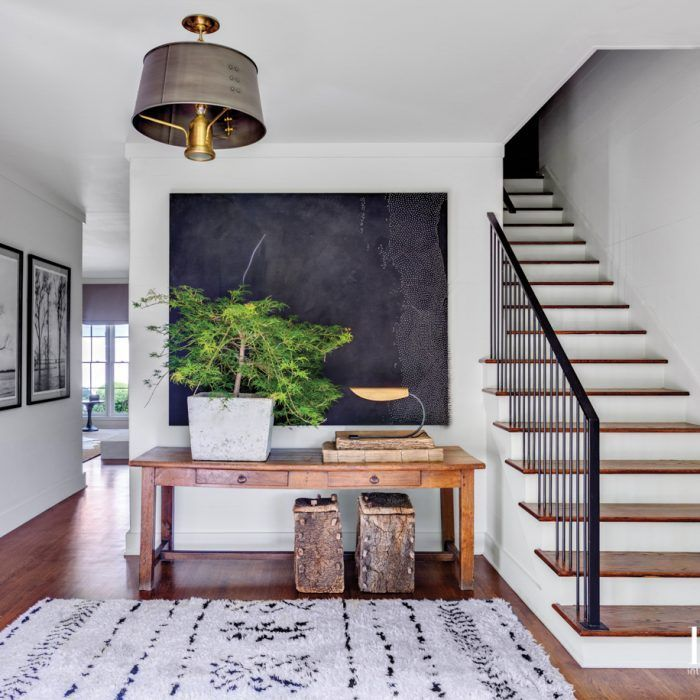 The Golden Girl Blog | Home Decor Inspiration, stairway, blue rug, green plant, blue wall art, home sweet home, home inspiration, natural interior, traditional home, foyer, renovation