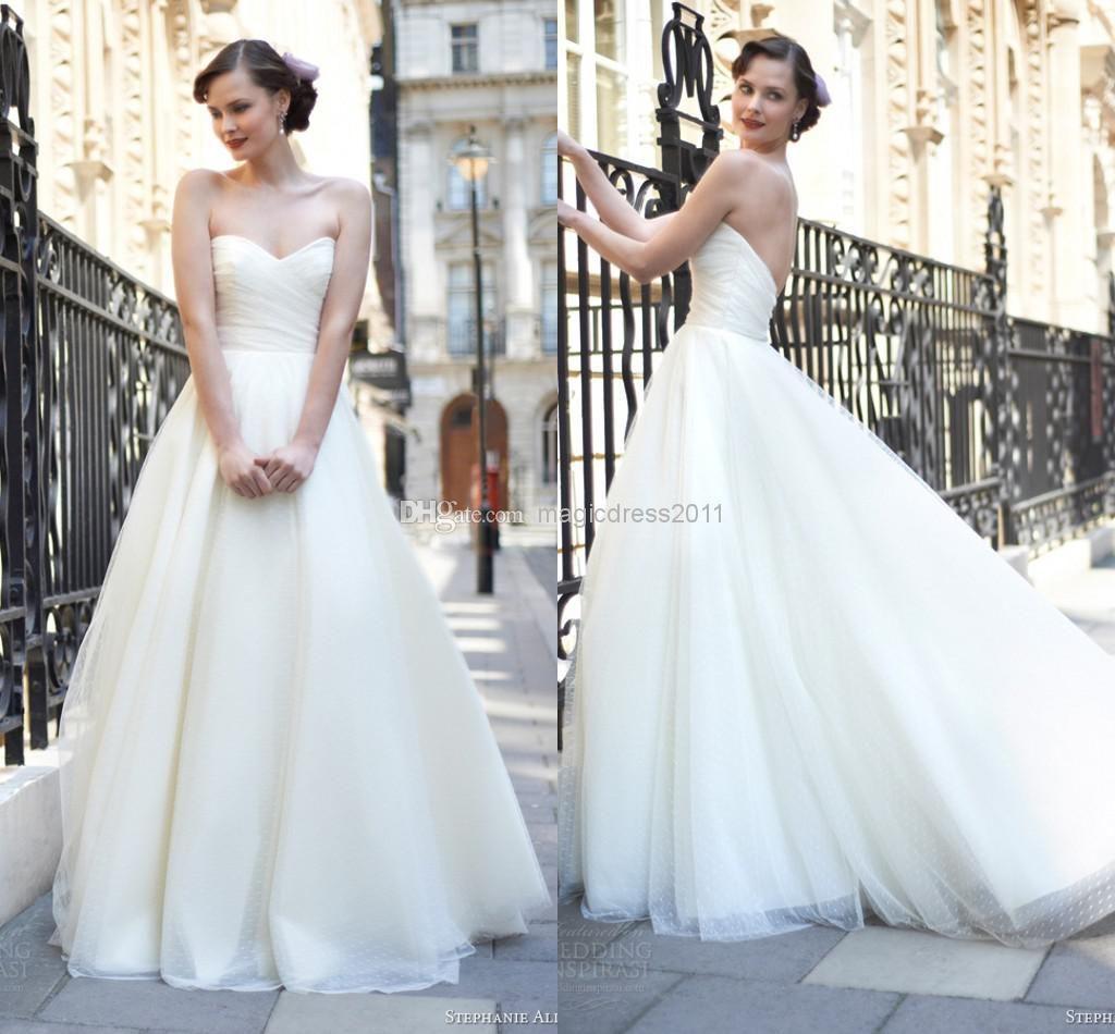 Beach wedding looks for bride  Cheap Wedding Gowns  Discount Sheer Backless Beach Wedding Gowns