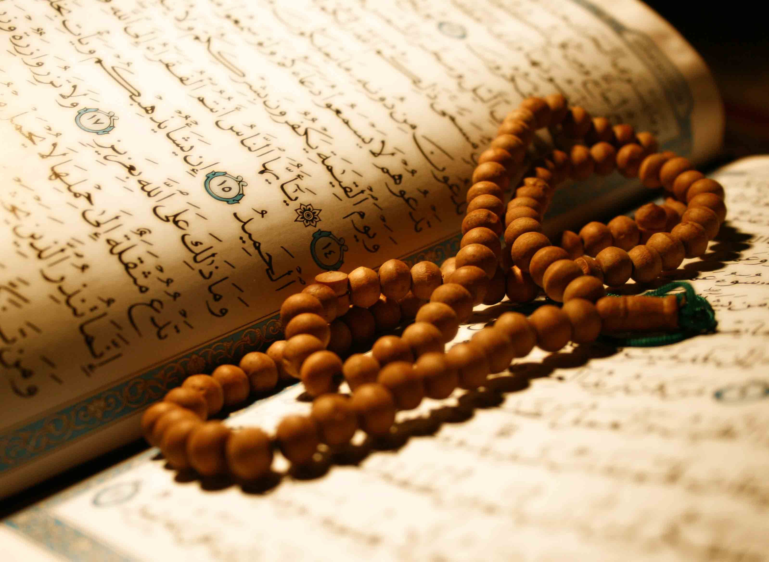 Image result for prayer beads and quran