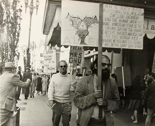 Allen Ginsberg At A Demonstration In San Francisco Oct 1963 Sign Reads War Is Black Magic Belly Flowers To North A South Vietnam Dogfight Musical Enemy