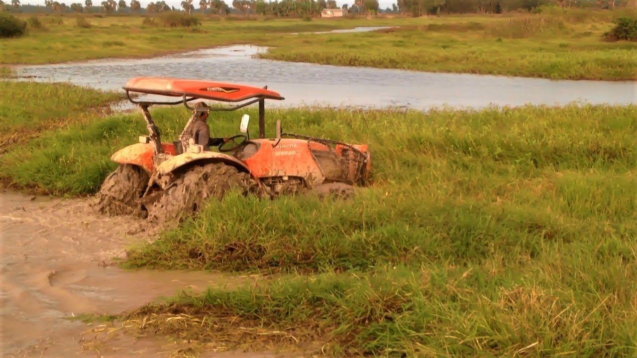 Amazing tractor kubota M6040SU stuck in mud Tractor