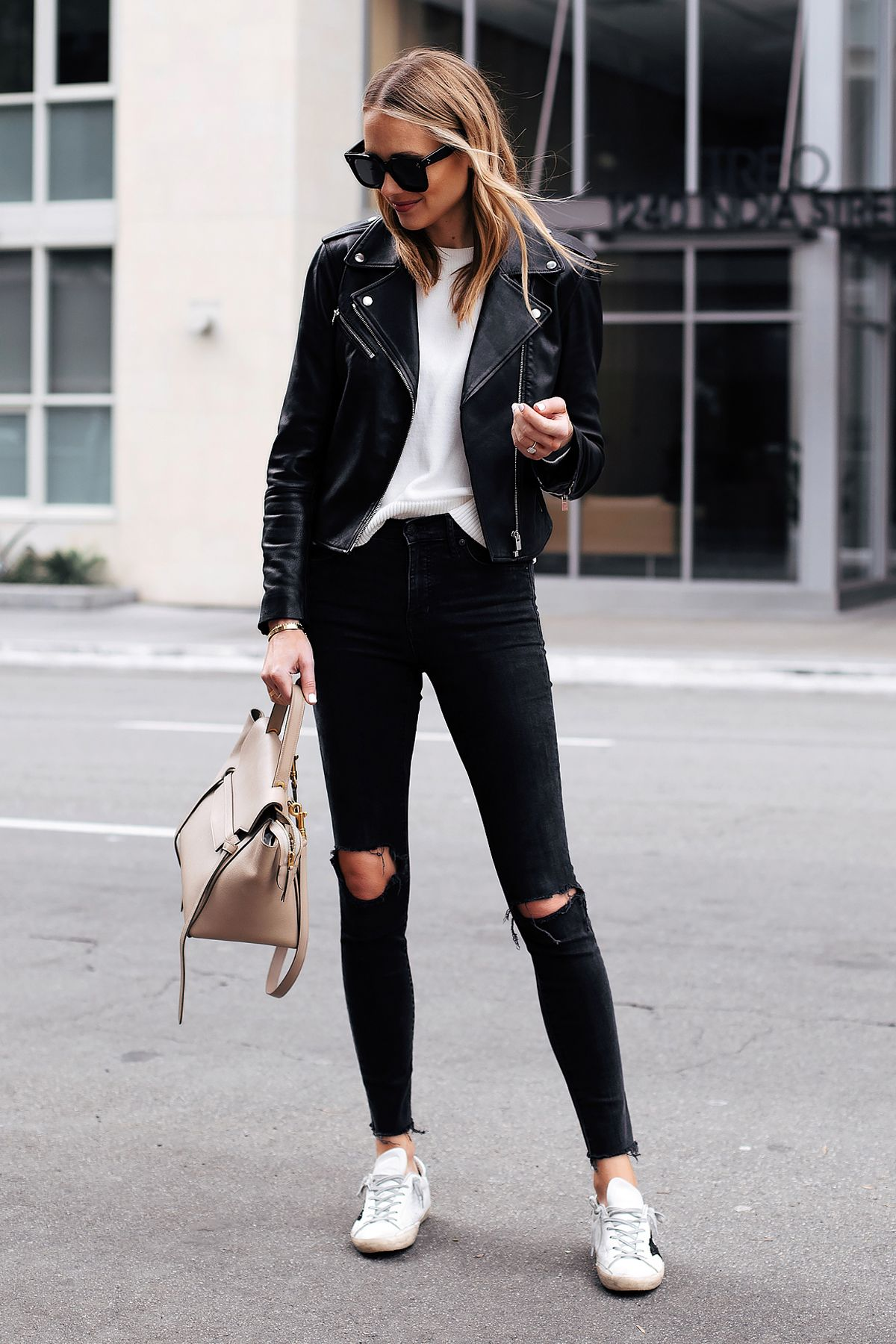 Fashion Jackson Capsule Wardrobe Wearing Club Monaco Black Leather Jacket White Sweater Madewell Black Ripped Skinny Jeans Golden Goose Sneakers #leatherjacketoutfit