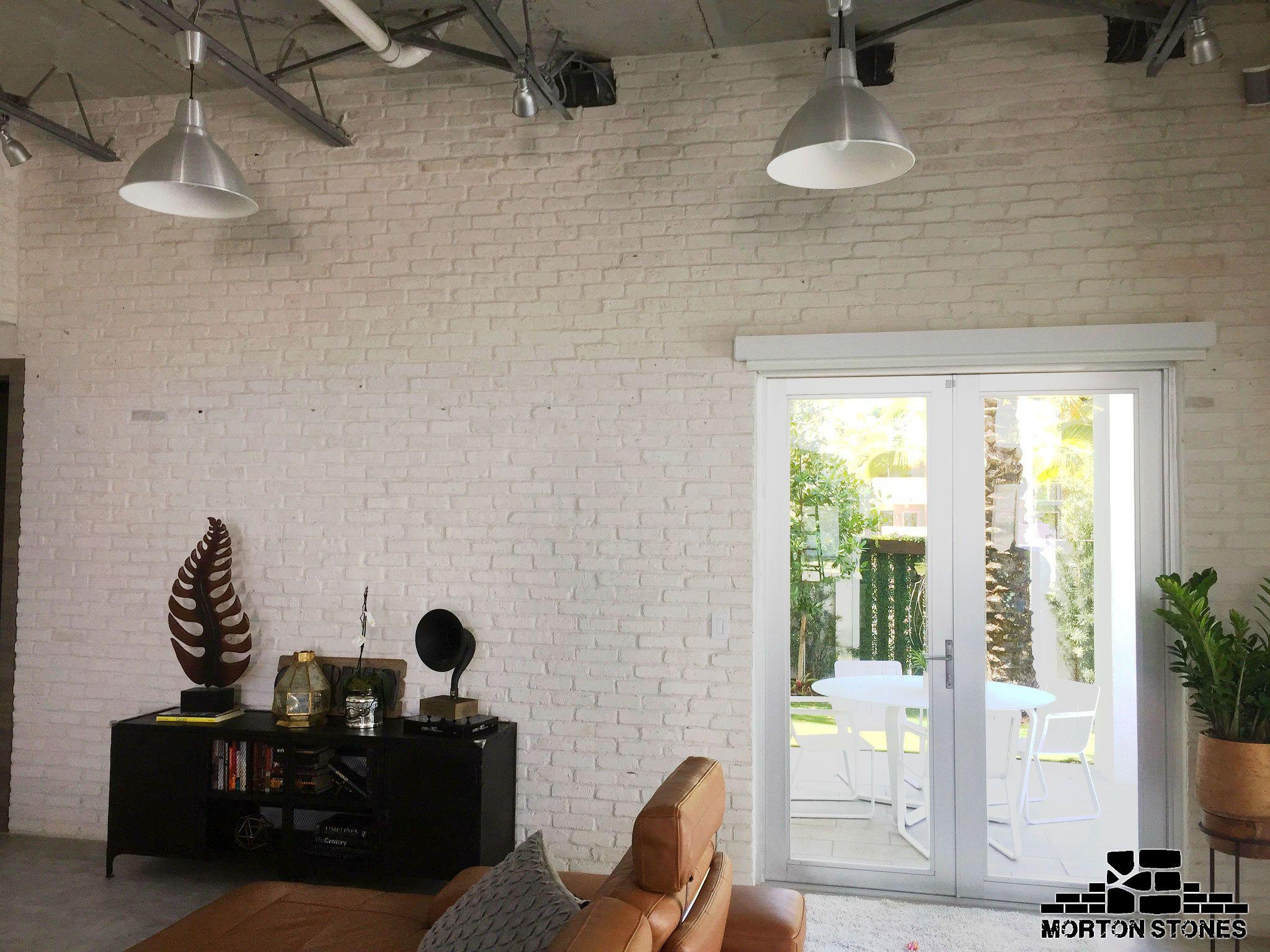 A white brick veneer wall in a modern living room. #mortonstones ...
