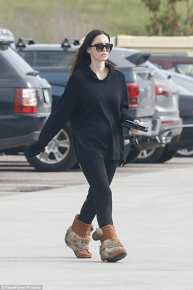 Keeping warm: The 30-year-old actress looked effortlessly stunning as she wore all black for her outing