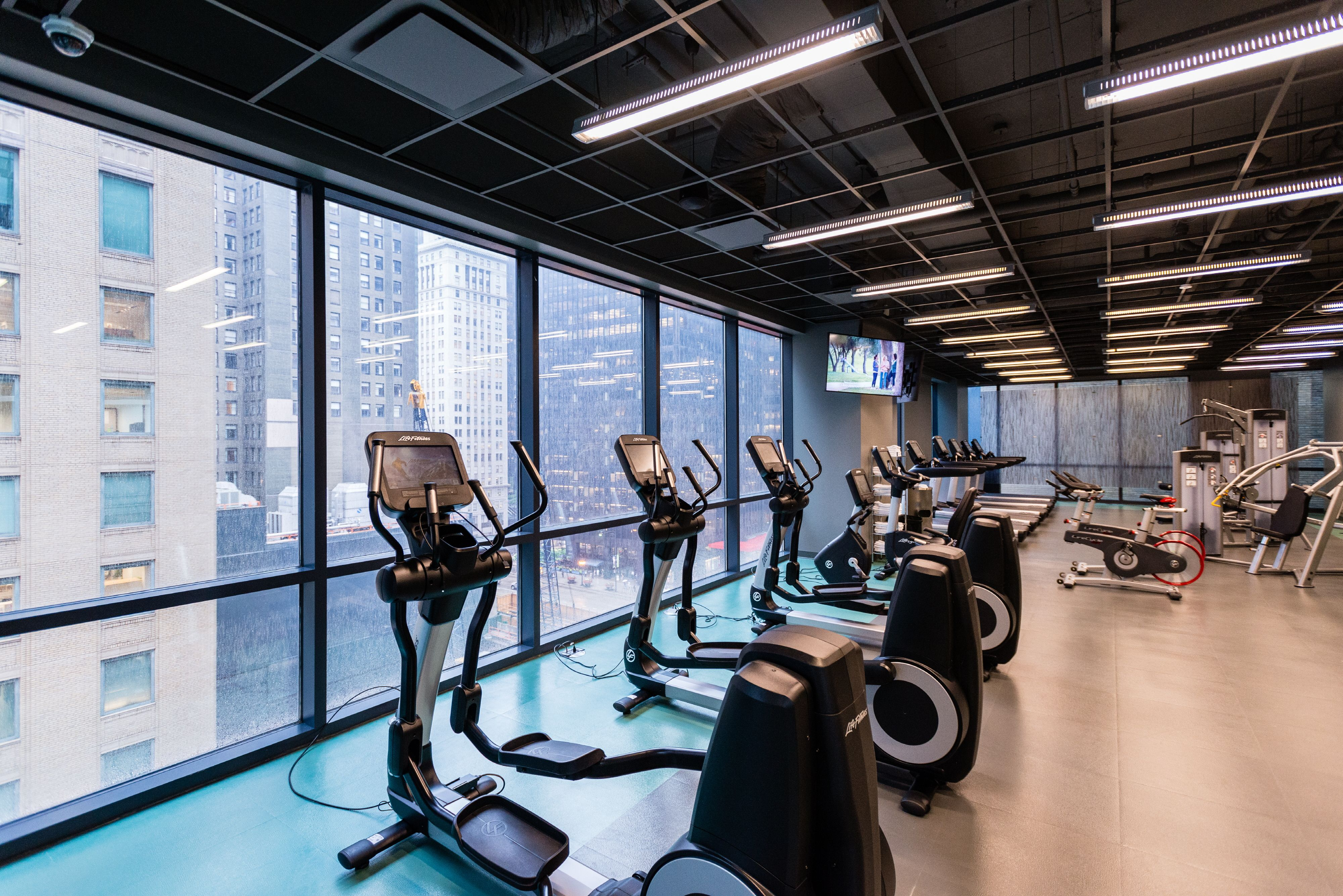 Another View Of The Cardio Equipment In Fitness Gym And City Views Experience73