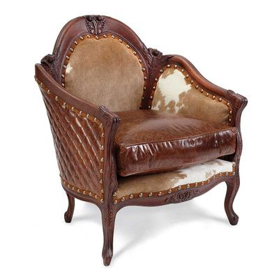 Beau BackOverviewThe King Ranch Carved Hair On Hide Chair Features A Beechwood  Frame That Is Ornately Hand