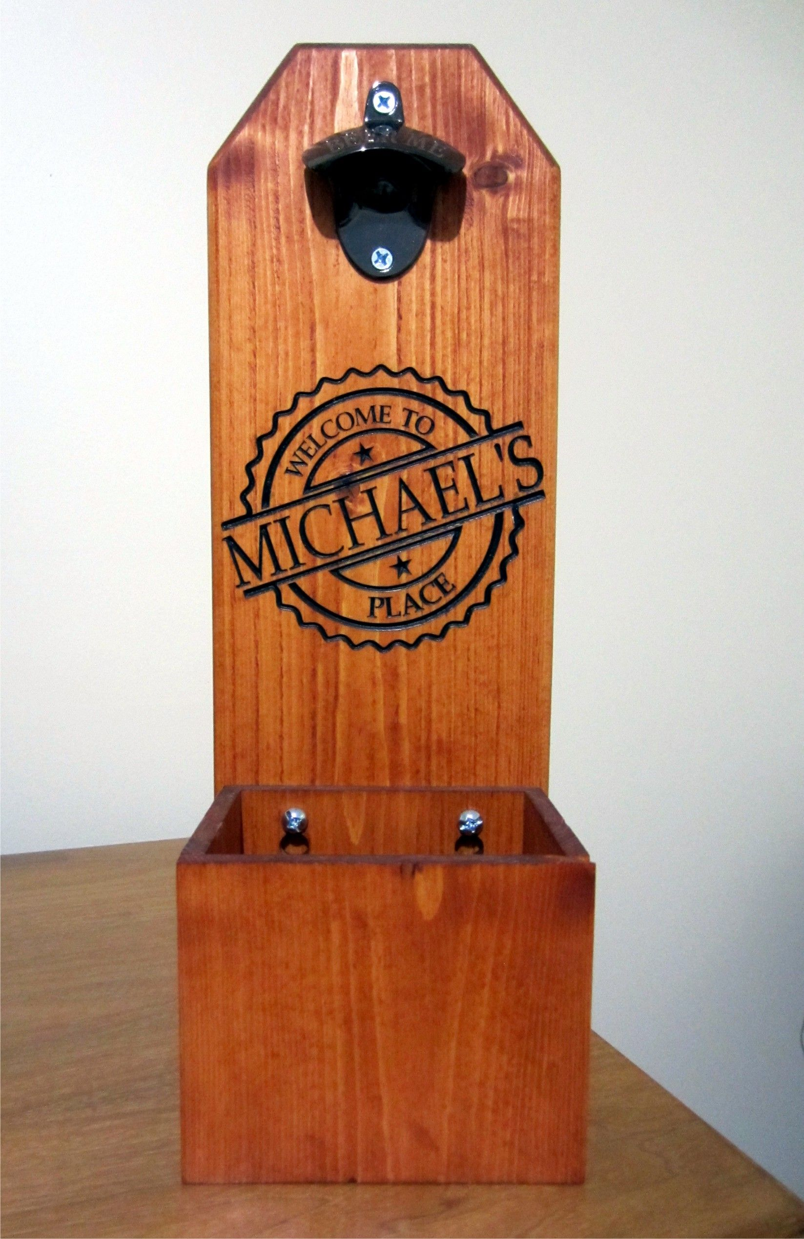 Beer bottle opener with removable catch box. Custom carved