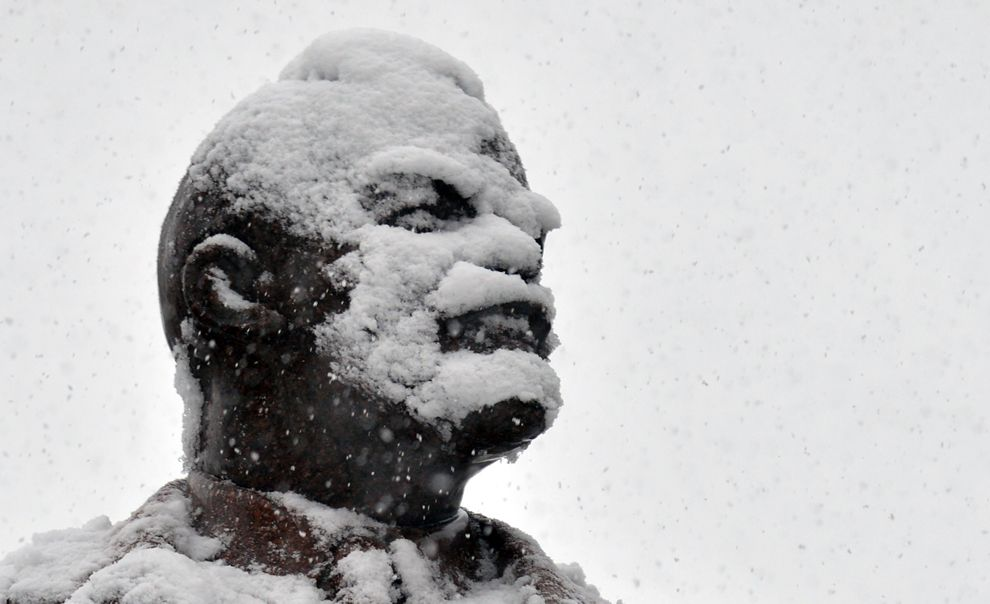 Lenin's statue is covered with snow during heavy snowfall over Kiev on Dec. 11. (Sergei Supinsky/AFP/Getty Images)