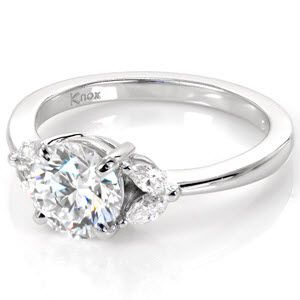 The 1.25 carat round diamond shines brilliantly in this high polished 14k white gold setting.