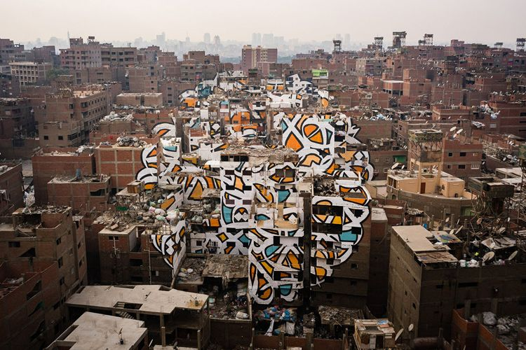 Tunisian street artist eL Seed has transformed the neighborhood of Manshiyat Nasr in Cairo into a massive work of street art