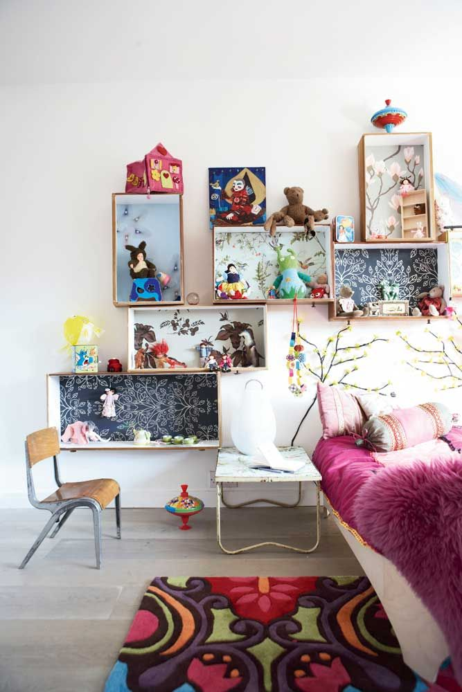 I love these shelves, almost like different dollhouse rooms on the wall.