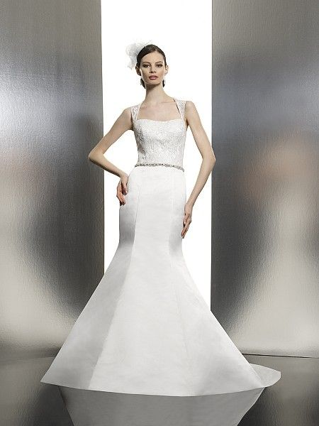 Moonlight Style T627 A figure flattering mermaid gown with alencon lace fabric draped over rich satin. The lace bodice features a soft sweetheart neckline and open back. A Swarovski encrusted sash is included.