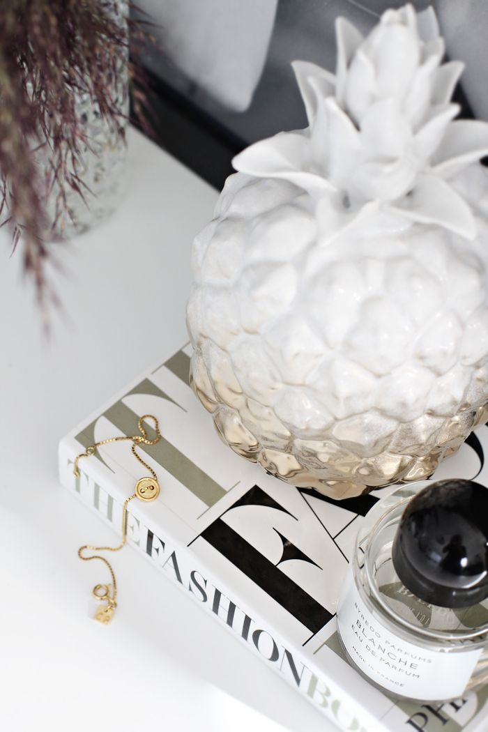 White and golden pineapple on a desk