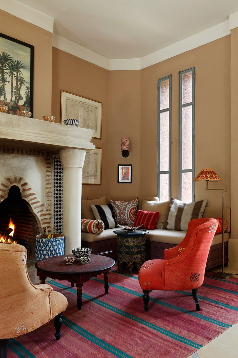 The head of publicity at Sybil Colefax & John Fowler's elegant Moroccan home is part of Elegant Living Room With Fireplace - The Moroccan holiday home of Trudi Ballard of Colefax and Fowler  An elegant house combining English country house style with traditional Moroccan elements