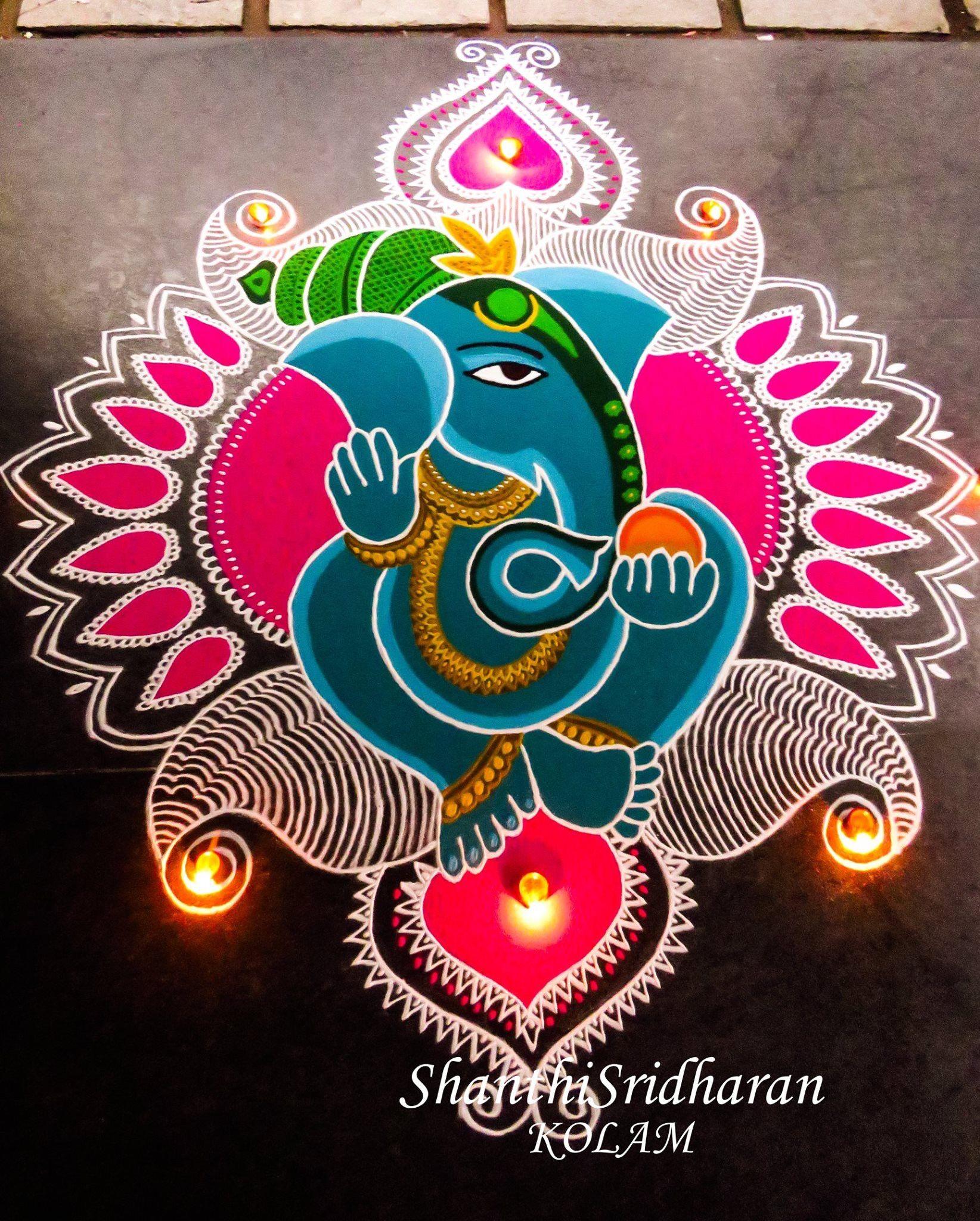 Simple peacock rangoli design for Diwali by Toshi