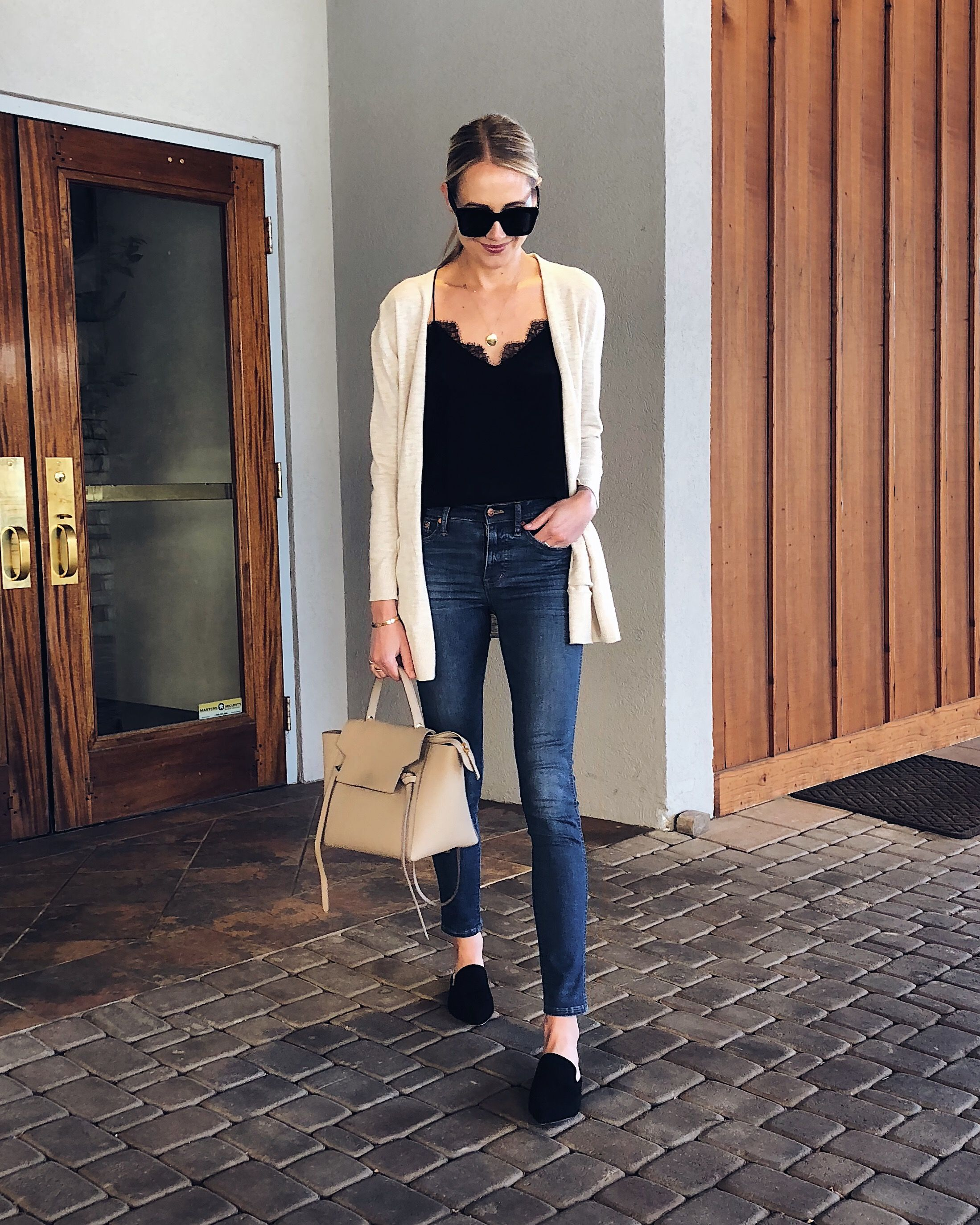 Blonde Woman Wearing Tan Cardigan Black Lace Cami Denim