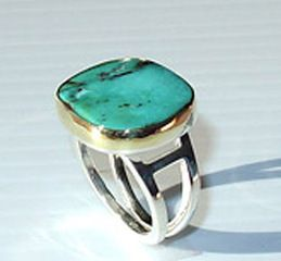 Turquoise Ring by Jeweller's Guild. handcut turquoise with sterling silver square wire. The bezel is 18k green gold, which sets off the turquoise especially well. American Made. 2013 Buyers Market of American Craft. americanmadeshow.com