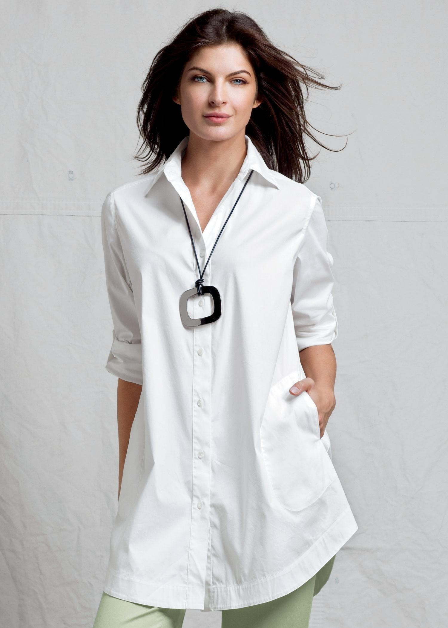 need this big white tunic -length shirt with a shaped hem in my closet for summer....