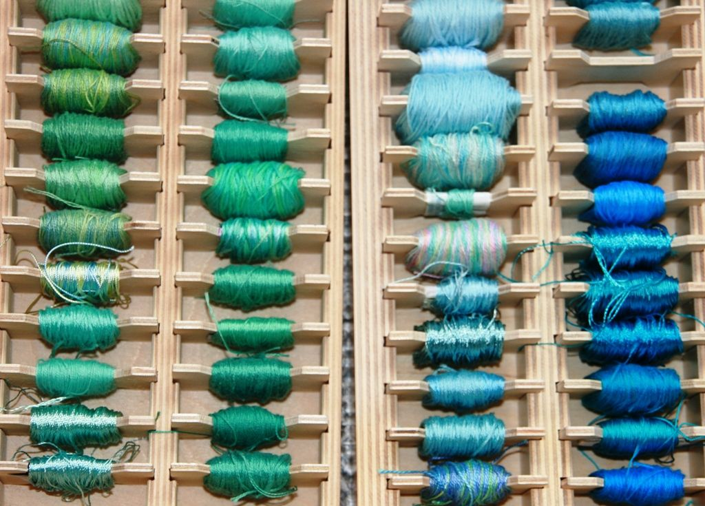 A collection of threads organised by colour