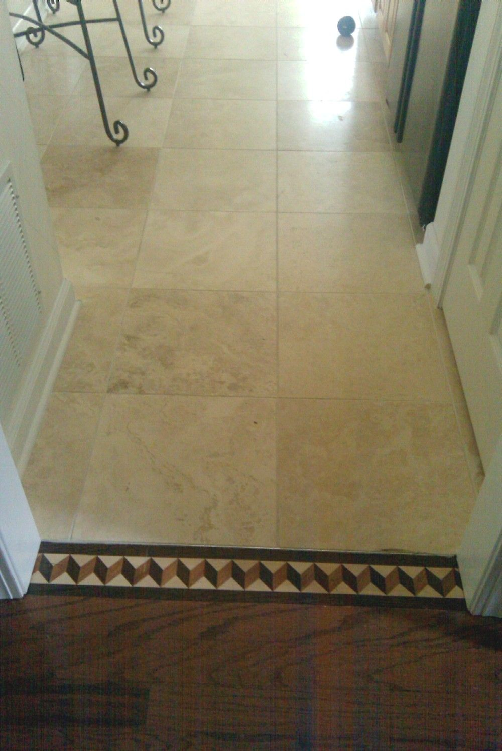 Border transition from wood floor to tile flooring for Floor tiles border design