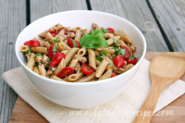 Caprese Pasta Salad Ingredients  1/4 cup olive oil 1/4 cup balsamic vinegar 2 tablespoons minced shallot 1 clove garlic, minced Salt and pepper, to taste 1 teaspoon sugar 2 cups cherry or grape tomatoes, halved 12 ounces uncooked pasta, such as campanelle, penne or fusilli 8 ounces fresh mozzarella cheese, cut into 1/2-inch pieces 1/3 cup chopped fresh basil 1/2 teaspoon grated lemon zest Instructions