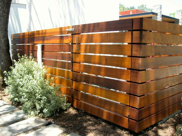 Dark Stained Wood Privacy Fence With Horizontal 2x6 Slats And Thick 4x4 Posts Gaps Appear To Be 1 Inch Between Slats Backyard Fences Fence Decor Fence Design