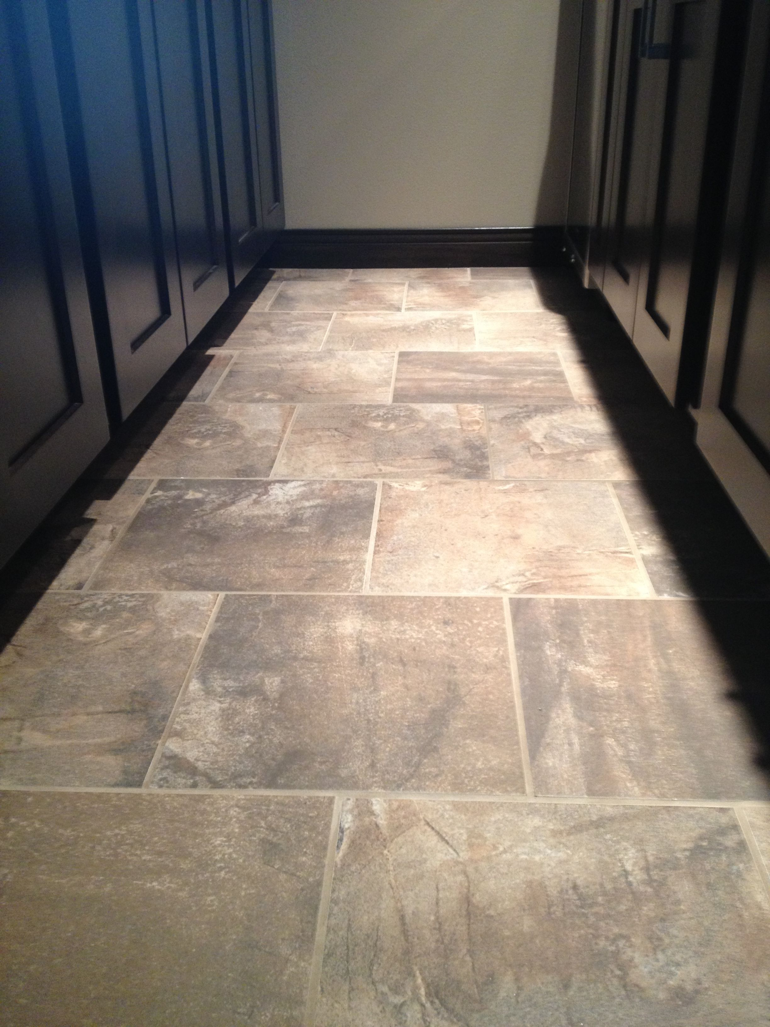 Gerard homes 2013 parade 13x13 porcelain tile flooring in a 13x13 porcelain tile flooring in a staggered pattern dailygadgetfo Choice Image