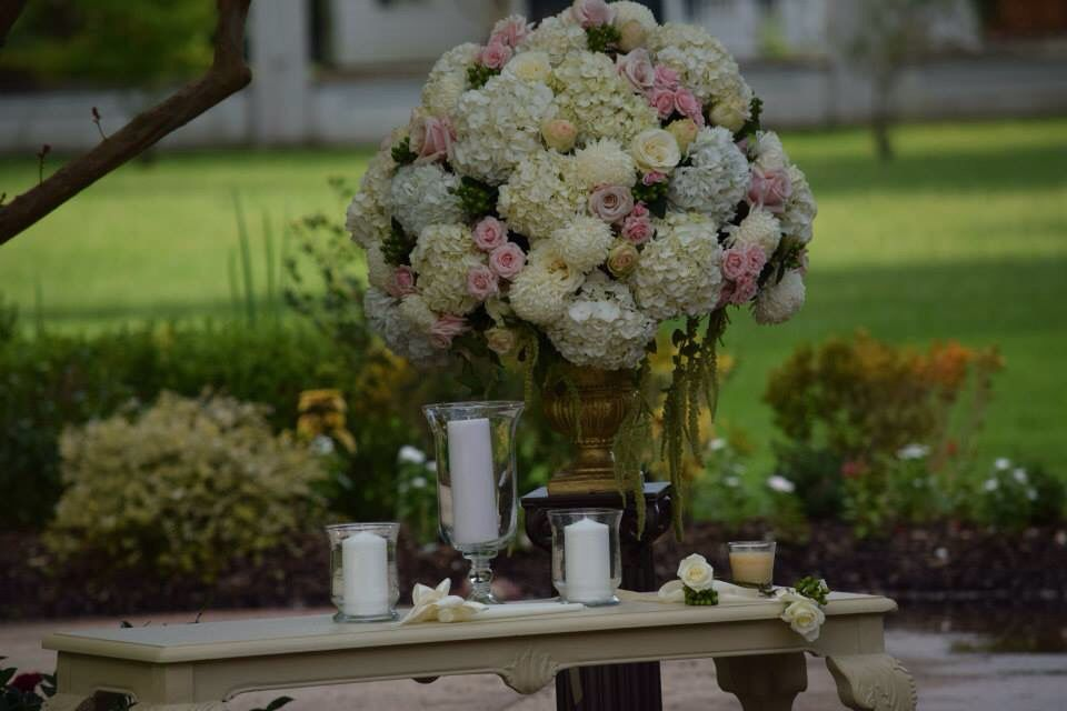 White hydrangea , pink and blush roses in ball shape.