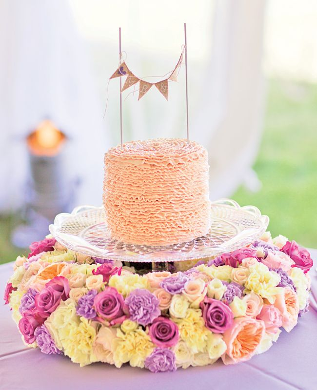 Floral crown for base of the wedding cake // Photo: Harris Studio // Featured: The Knot Blog
