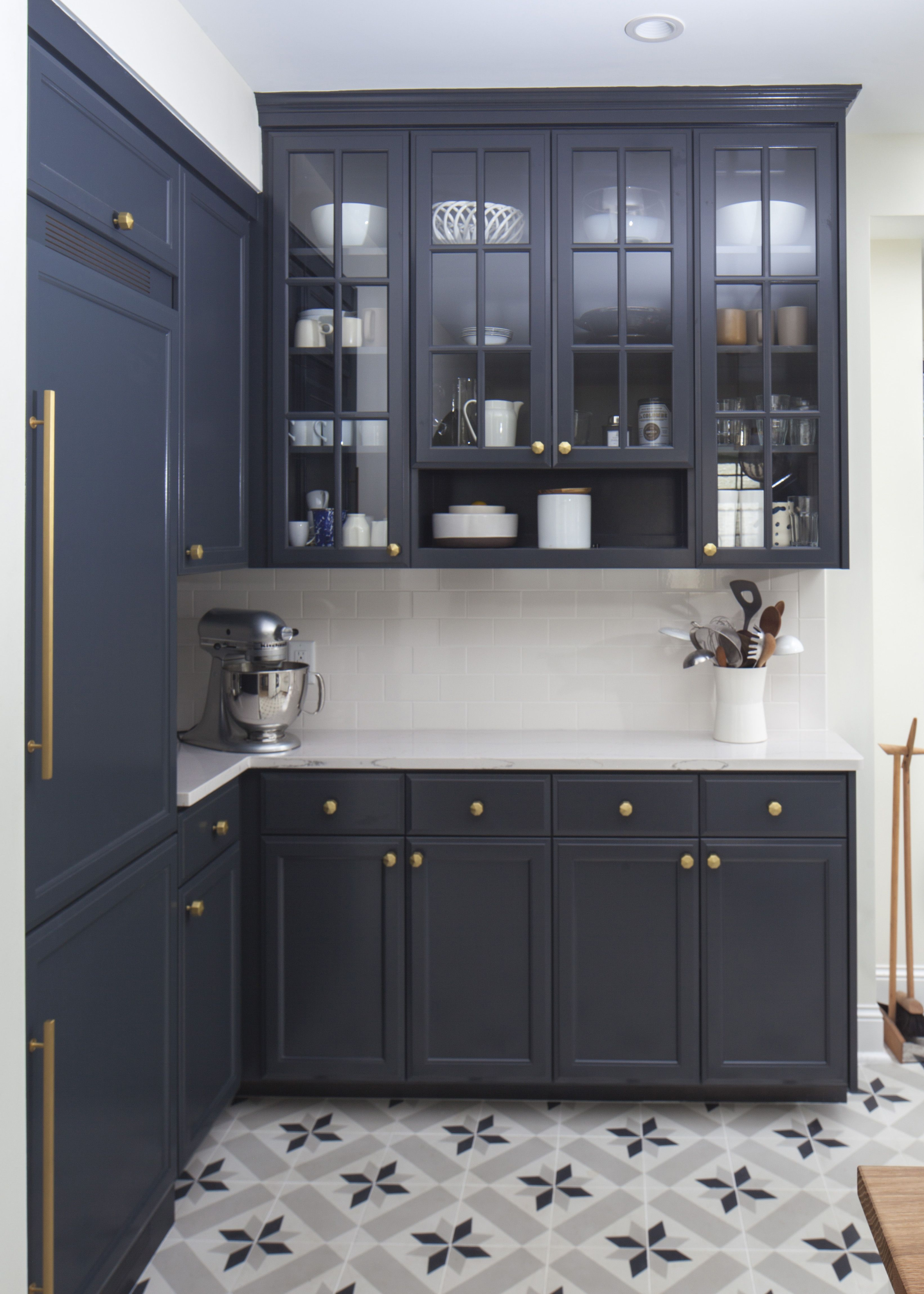navy cabinets, glass front on top. patterned tile floor. | kitchen