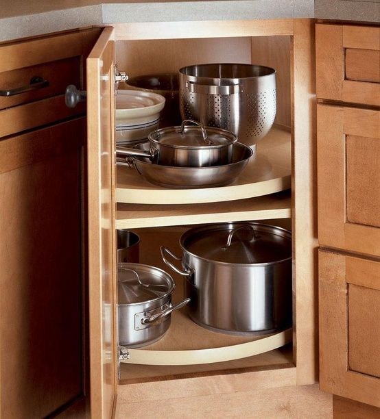Store Pots And Pans Together To Prevent Mixups Tips From Professional Organizer Corner Kitchen Cabinet Kitchen Corner Cupboard Corner Cabinet Kitchen Storage