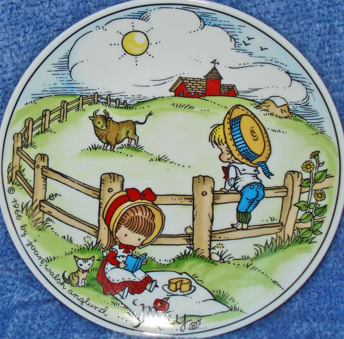 Joan Walsh Anglund, May 1966 (http://www.ebay.com/itm/1966-MAY-JOAN-WALSH-ANGLUND-7-3-4-CERAMIC-PLATE-BOY-GIRL-ON-FARM-PICNIC-/221429254461?pt=LH_DefaultDomain_0hash=item338e36493d)