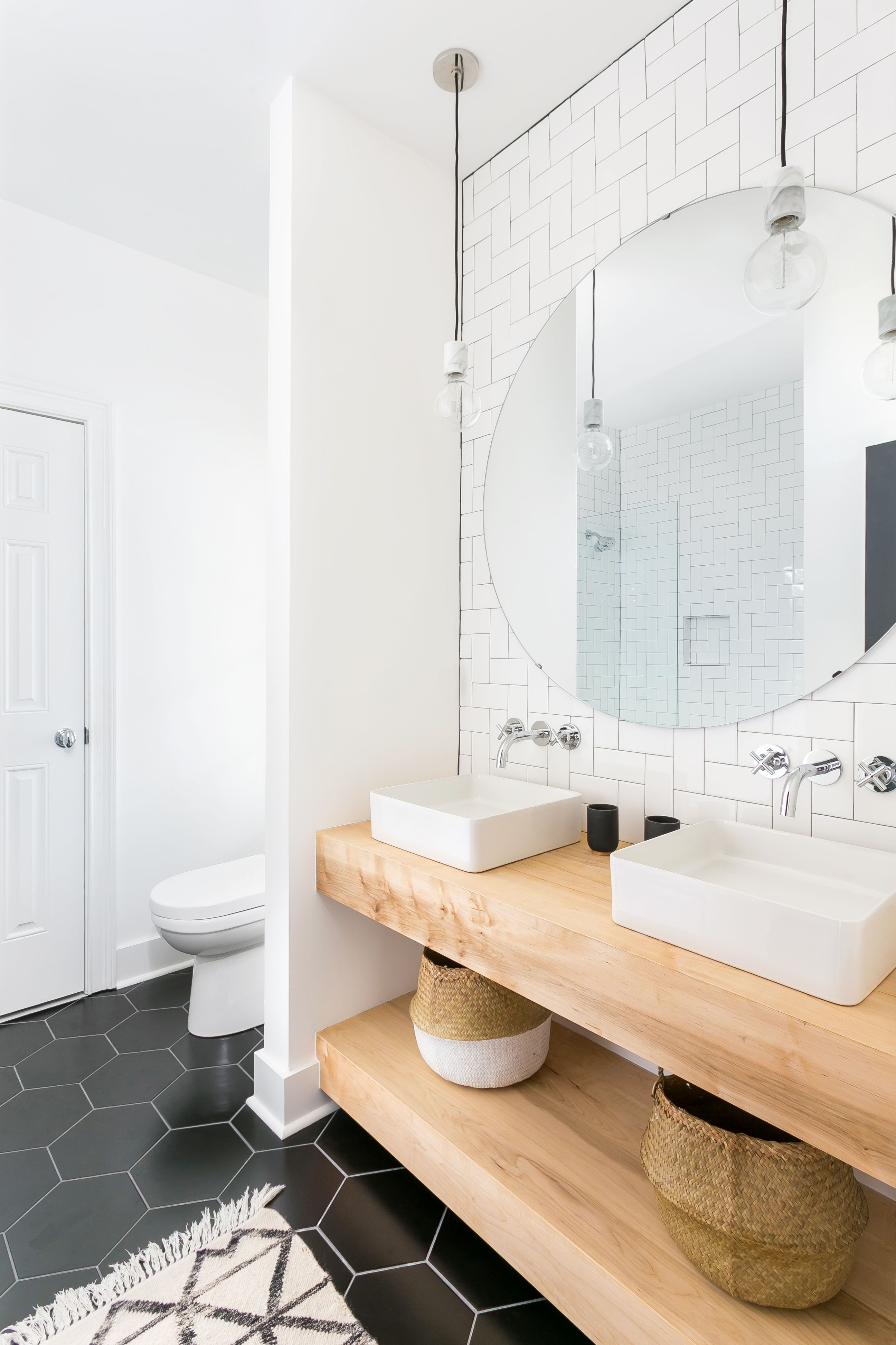 Modern Bathroom With Herringbone Subway Tile Black Hex Floor Tile